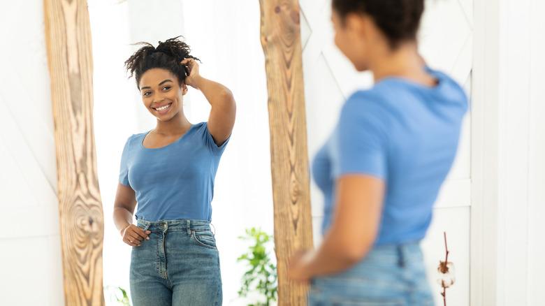 Woman smiling looking in mirror