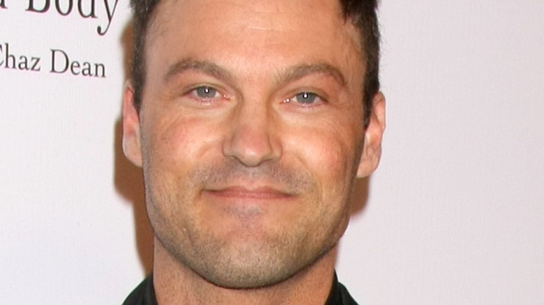 Brian Austin Green smiling for the camera at an event