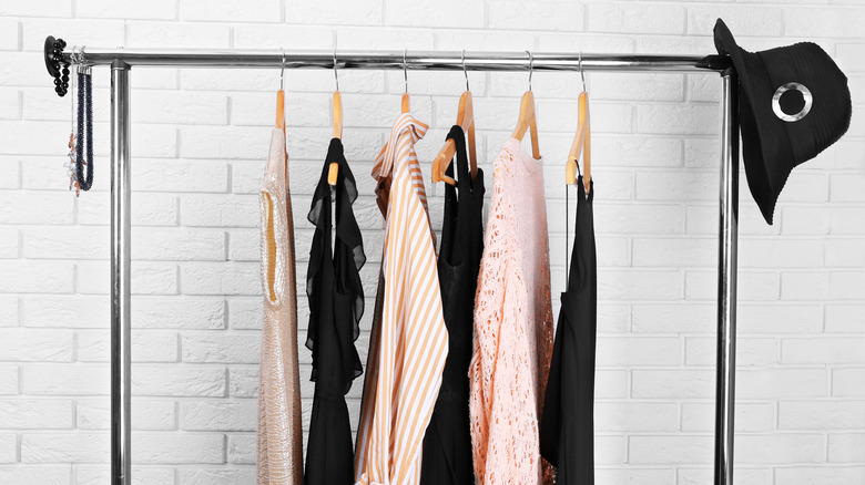 black and peach clothes on a clothing rack