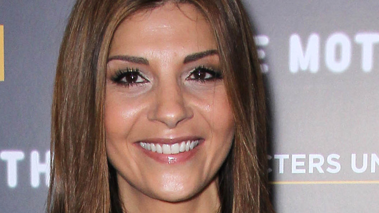 Callie Thorne smiling hair parted down the middle