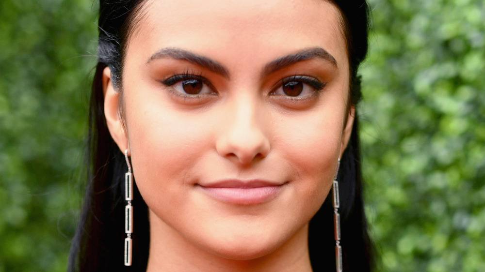Actor Camila Mendes grinning