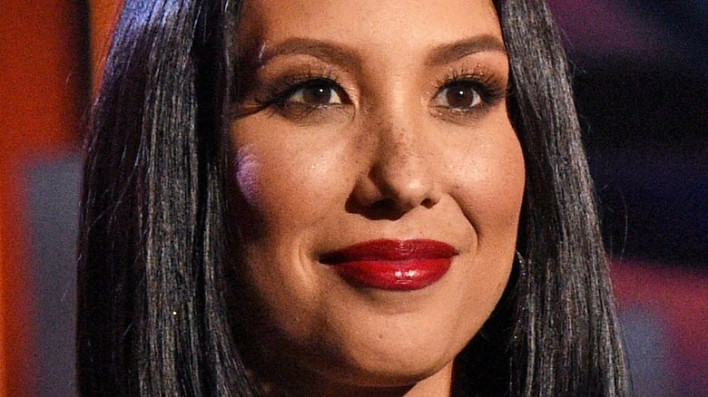 Cheryl Burke smiling at an event.
