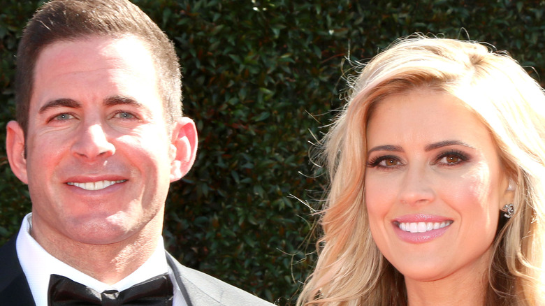Christina Haack and Tarek El Moussa in front of greenery