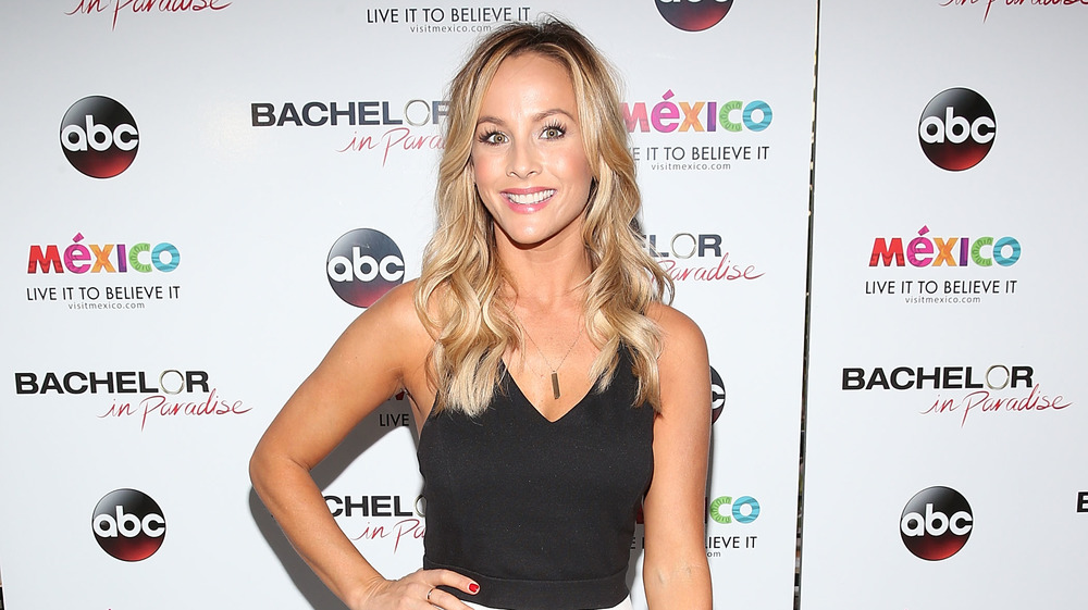 Bachelorette Clare Crawley in front of step and repeat