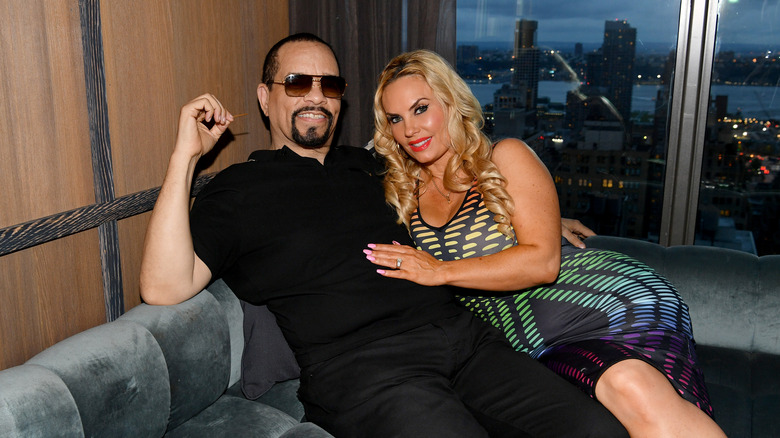 Coco Austin and Ice-T reclining on a couch