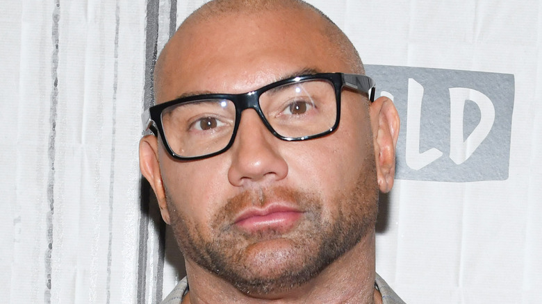 Dave Bautista poses on the red carpet