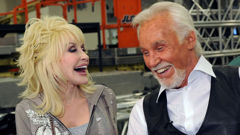Dolly Parton and Kenny Rogers laughing