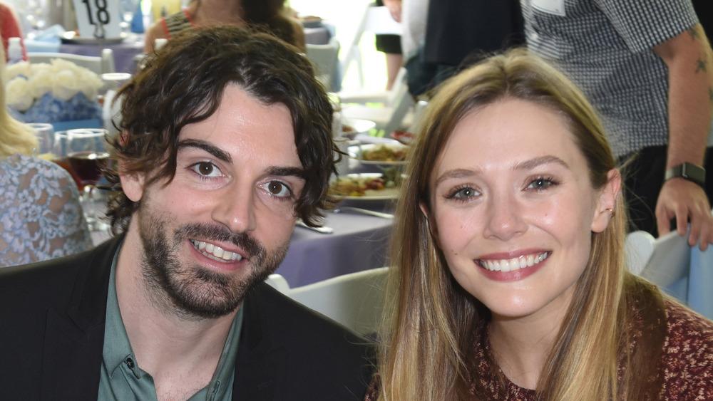 Elizabeth Olsen and Robbie Arnett at a restaurant