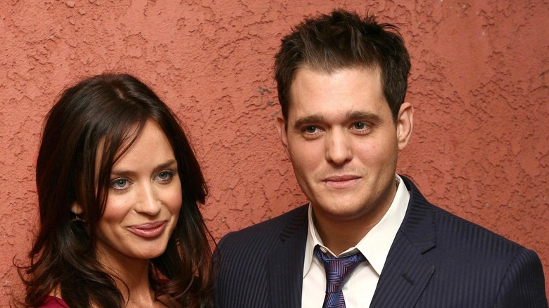 Emily Blunt and Michael Buble smiling
