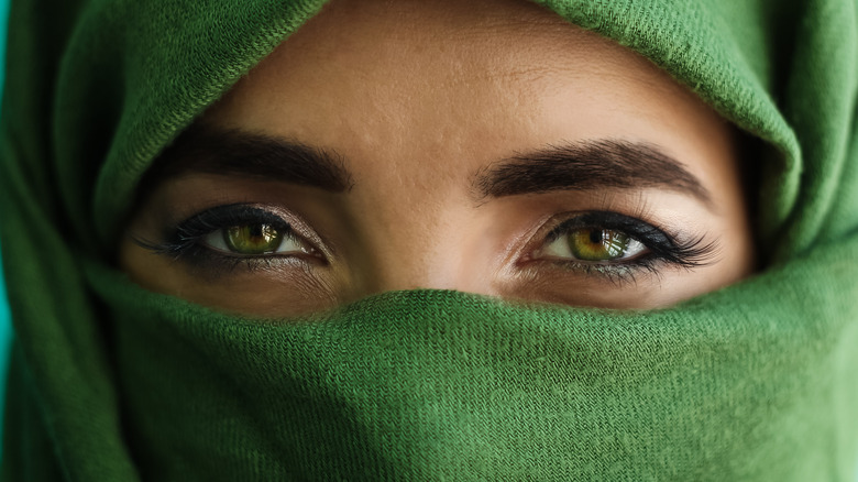 close up of woman with green eyes