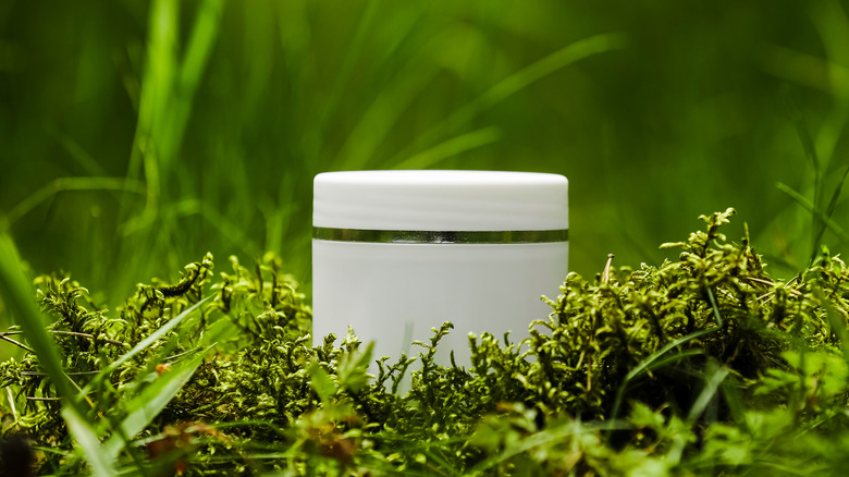 Cosmetic product in grass