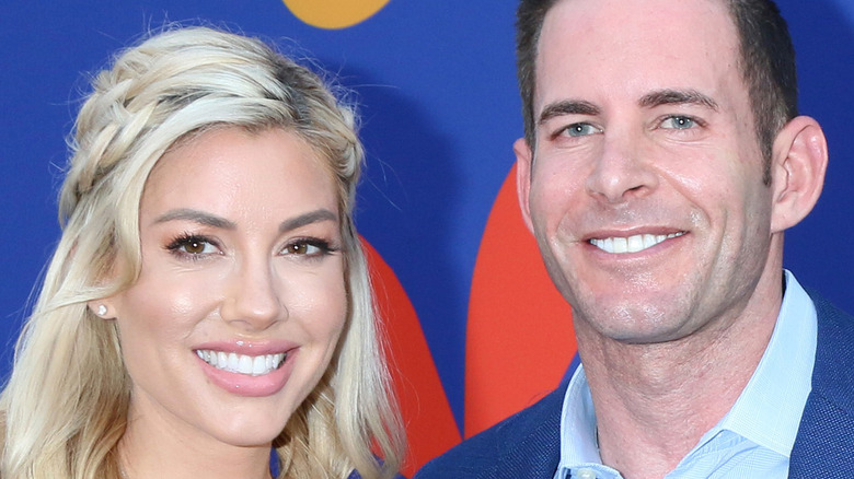 Heather Rae Young and Tarek El Moussa smiling