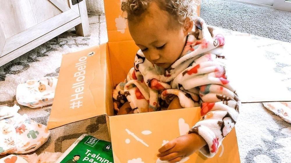 Baby in Hello Bello box