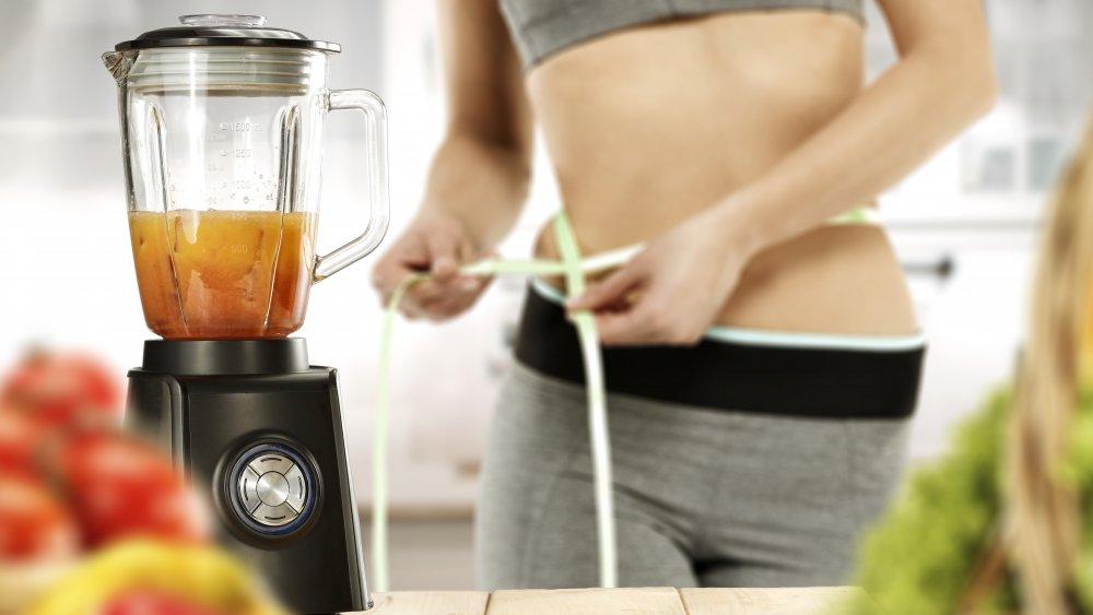 Woman drinking weight loss shake
