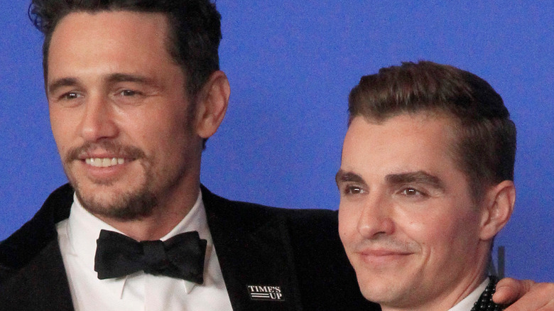 Brothers Dave and James Franco pose in tuxedos