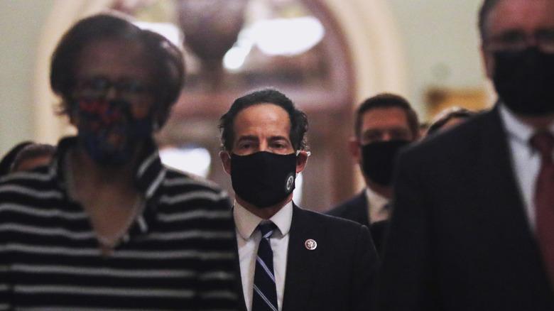 House rep Jamie Raskin in mask walking in Capitol