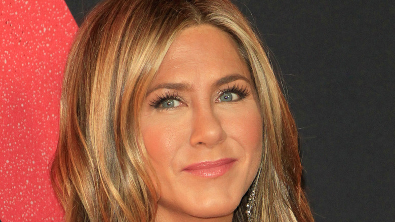Jennifer Aniston poses on the red carpet.