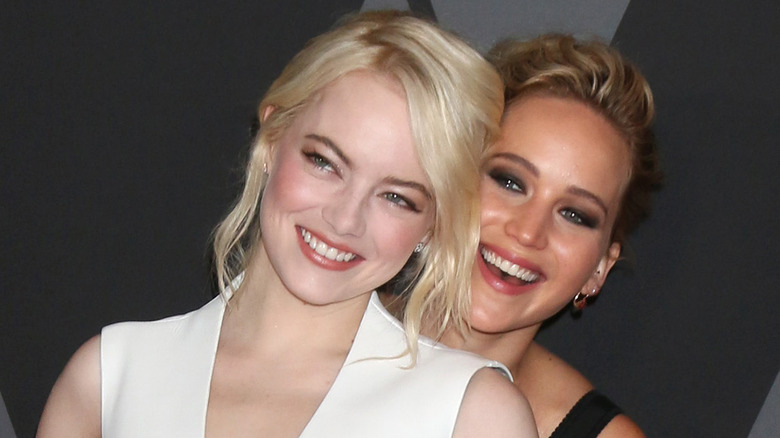 Jennifer Lawrence and Emma Stone at event
