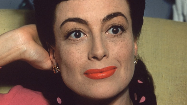 Joan Crawford posing