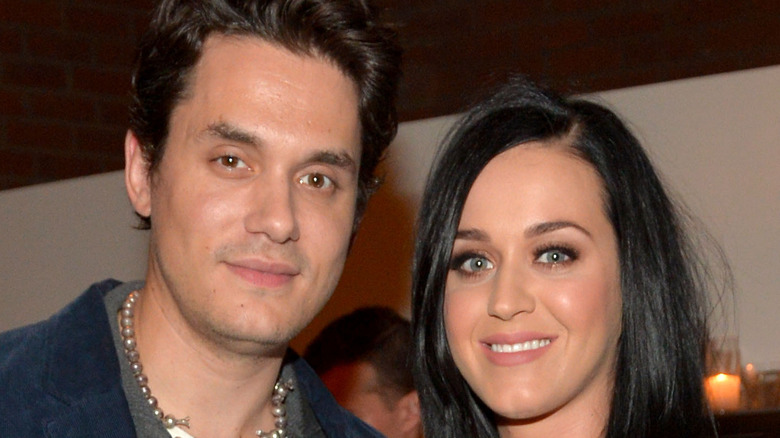 John Mayer and Katy Perry smiling, posing
