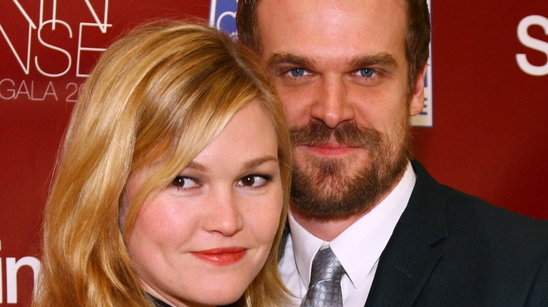 Julia Stiles and David Harbour pose on the red carpet together