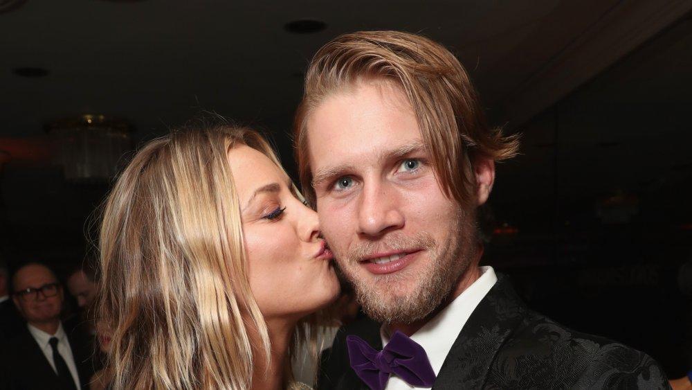Kaley Cuoco kissing her husband, Karl Cook, on the cheek
