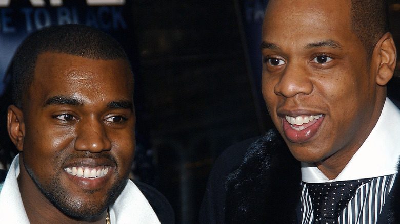 Kanye West and Jay-Z smiling