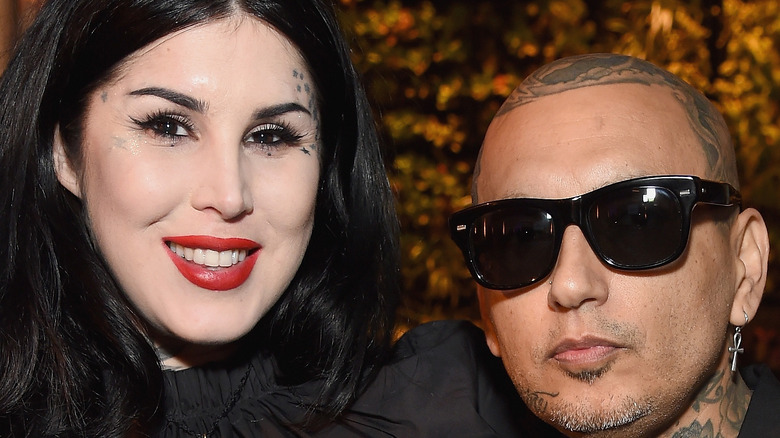Kat Von D and Rafael Reyes pose together at an event