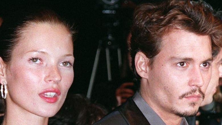 Johnny Depp and Kate Moss walking a red carpet