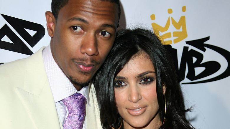 Nick Cannon and Kim Kardashian posing