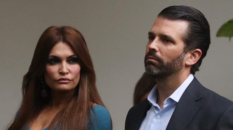 Donald Trump Jr. and Kimberly Guilfoyle together with serious expressions