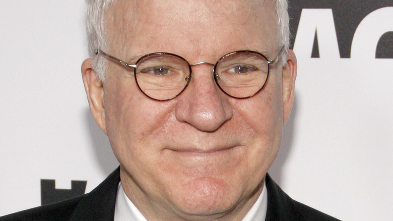 Steve Martin looking sage in glasses and a tuxedo