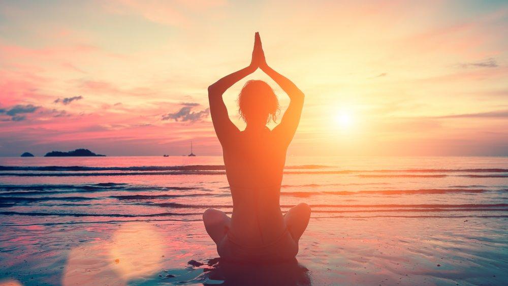 Dawn yoga meditation on a beach
