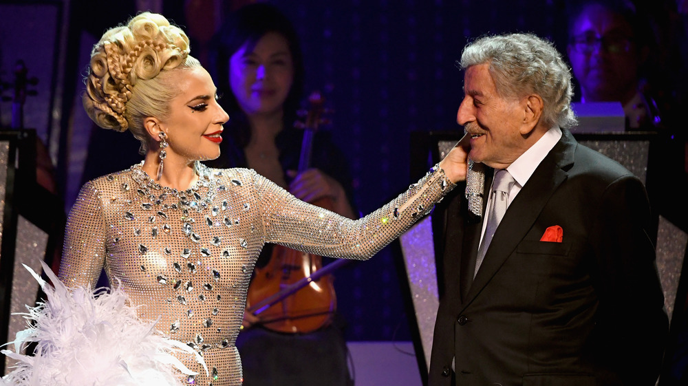 Lady Gaga caresses Tony Bennett onstage