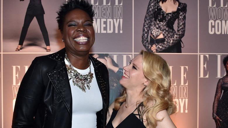 leslie jones and kate mckinnon smiling