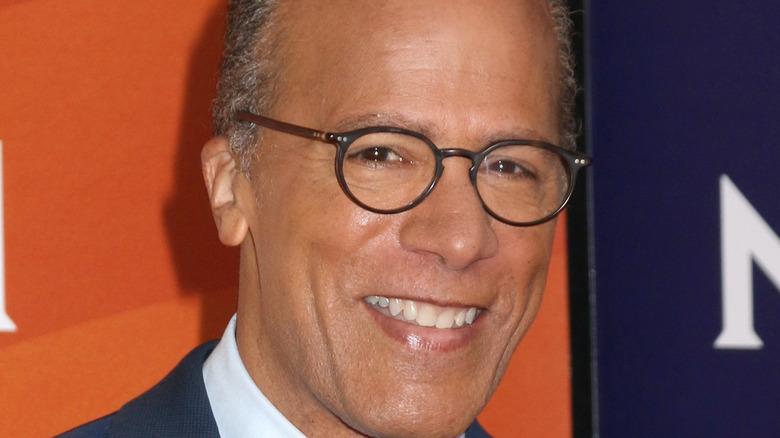Lester Holt smiling in glasses