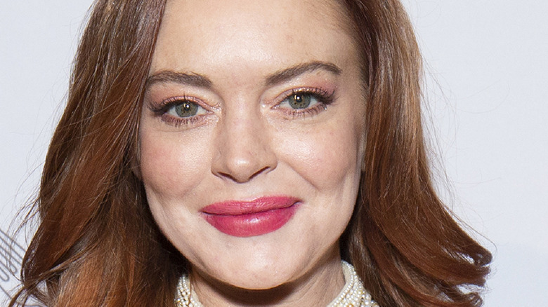 Lindsay Lohan poses on the red carpet