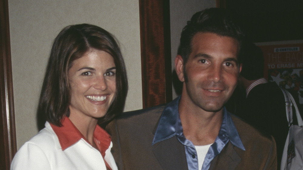 Lori Loughlin and Mossimo Giannulli in the '90s, smiling