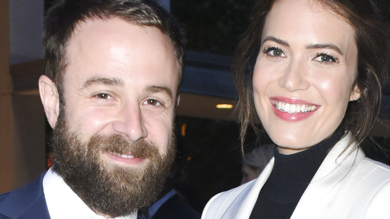 Taylor Goldsmith poses with wife Mandy Moore