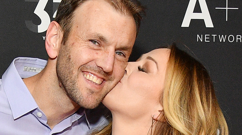 A couple from married at first sight kissing