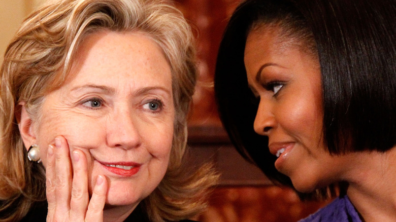 Hillary Clinton and Michelle Obama talking