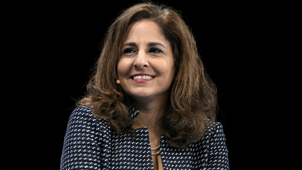 Neera Tanden looking off to the side and smiling