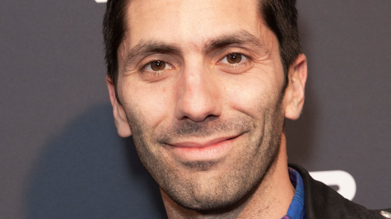 Nev Schulman smiles on the red carpet