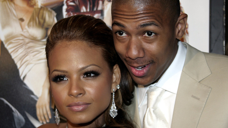 Nick Cannon and Christina Milian pose on the red carpet together