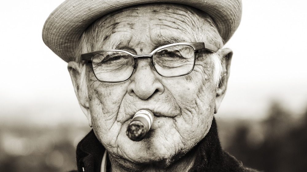 Norman Lear smoking cigar