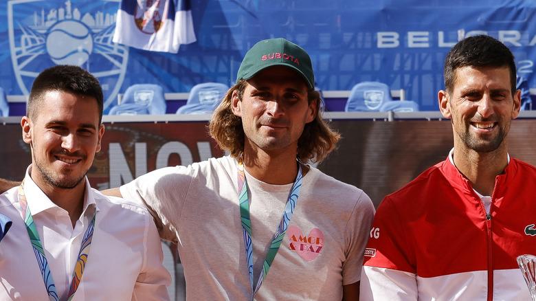 Novak, Marko and Djordje Djokovic on the tennis court
