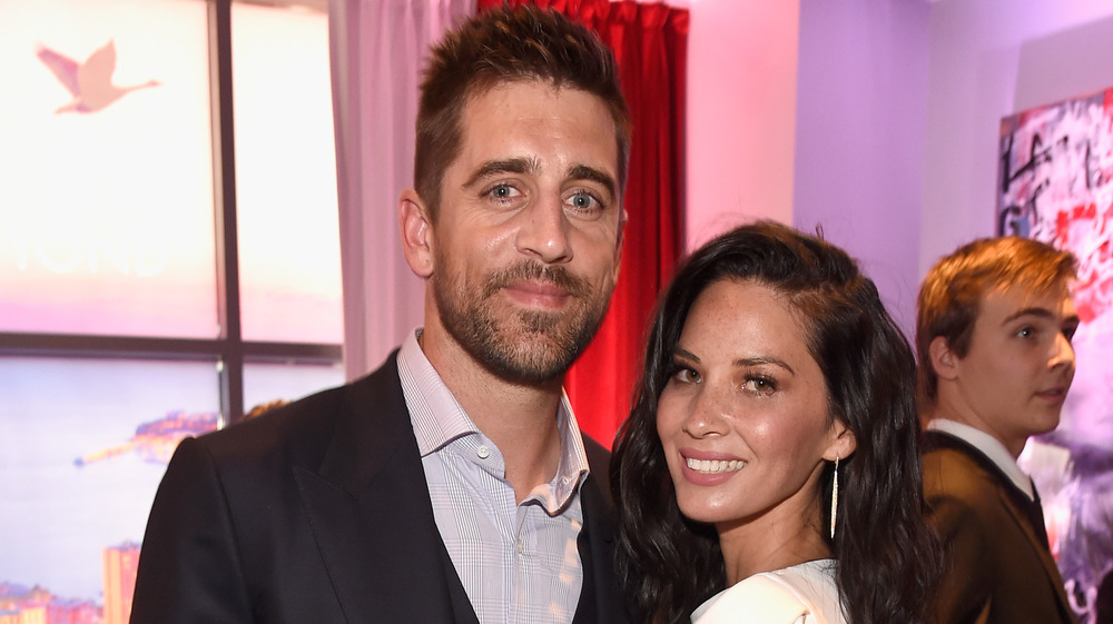 Olivia Munn and Aaron Rodgers attend an event
