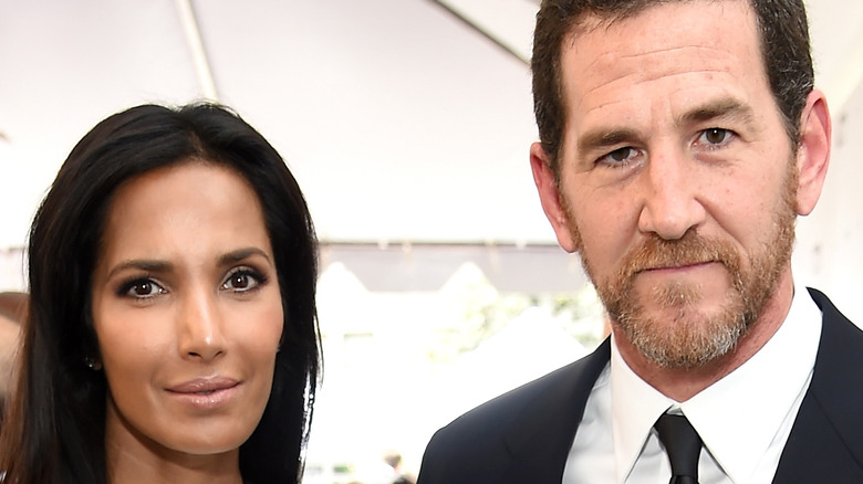 Padma Lakshmi and Adam Dell pose on the red carpet together