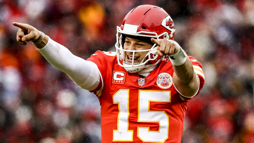 Patrick Mahomes smiling, pointing during game