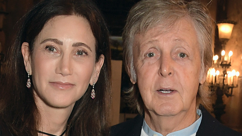 Paul McCartney and Nancy Shevell posing at event
